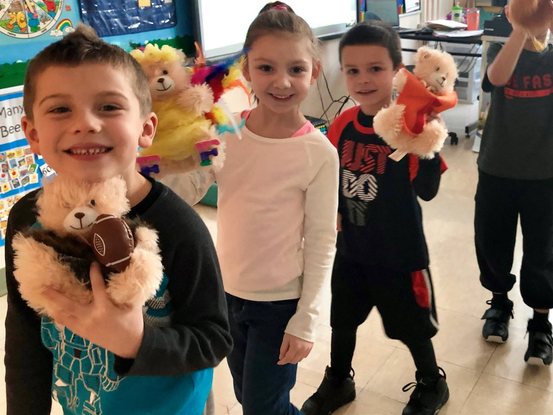 Kindergarten student pose with their bears