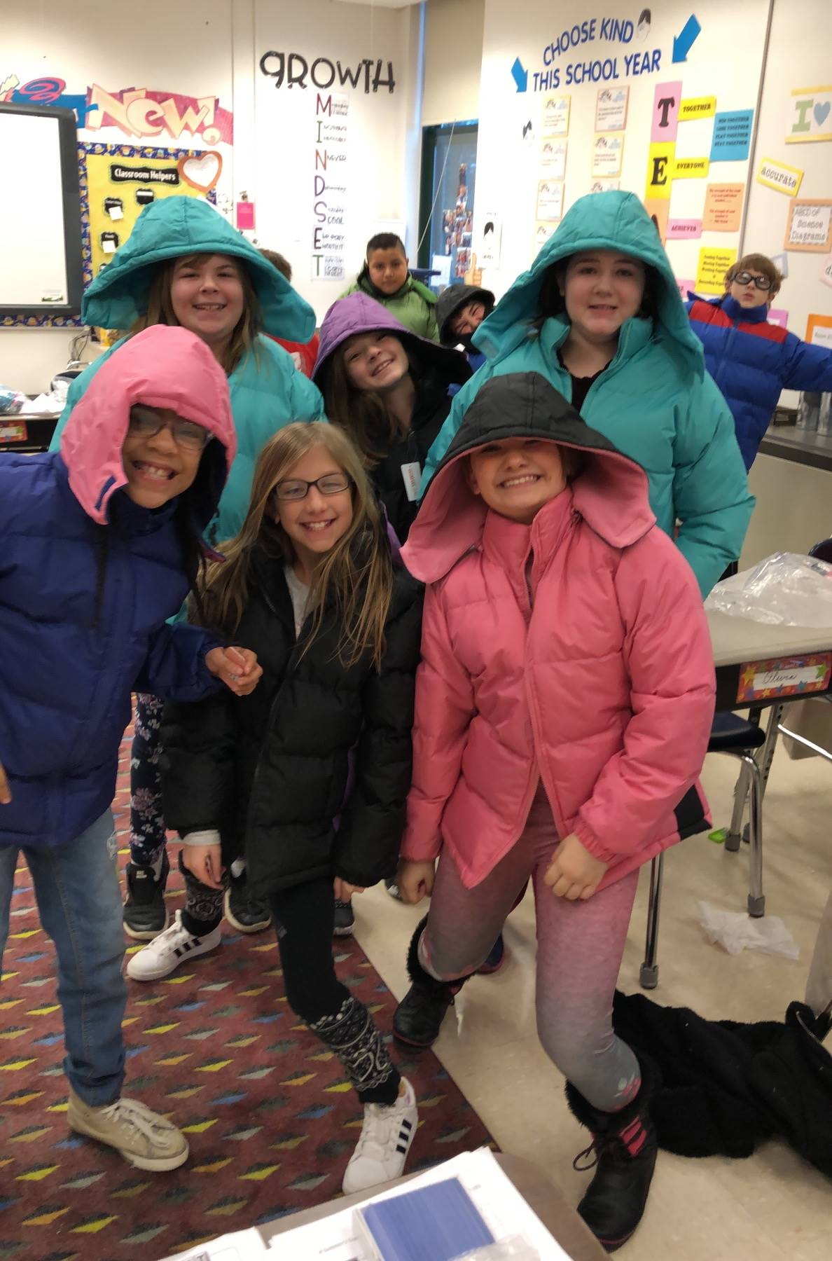 5th grade students try on their new coats