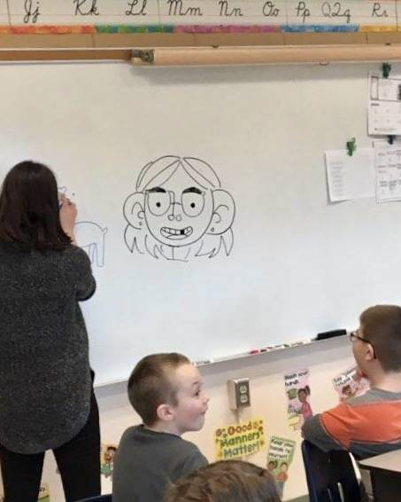 Illustrator showing students how to draw.