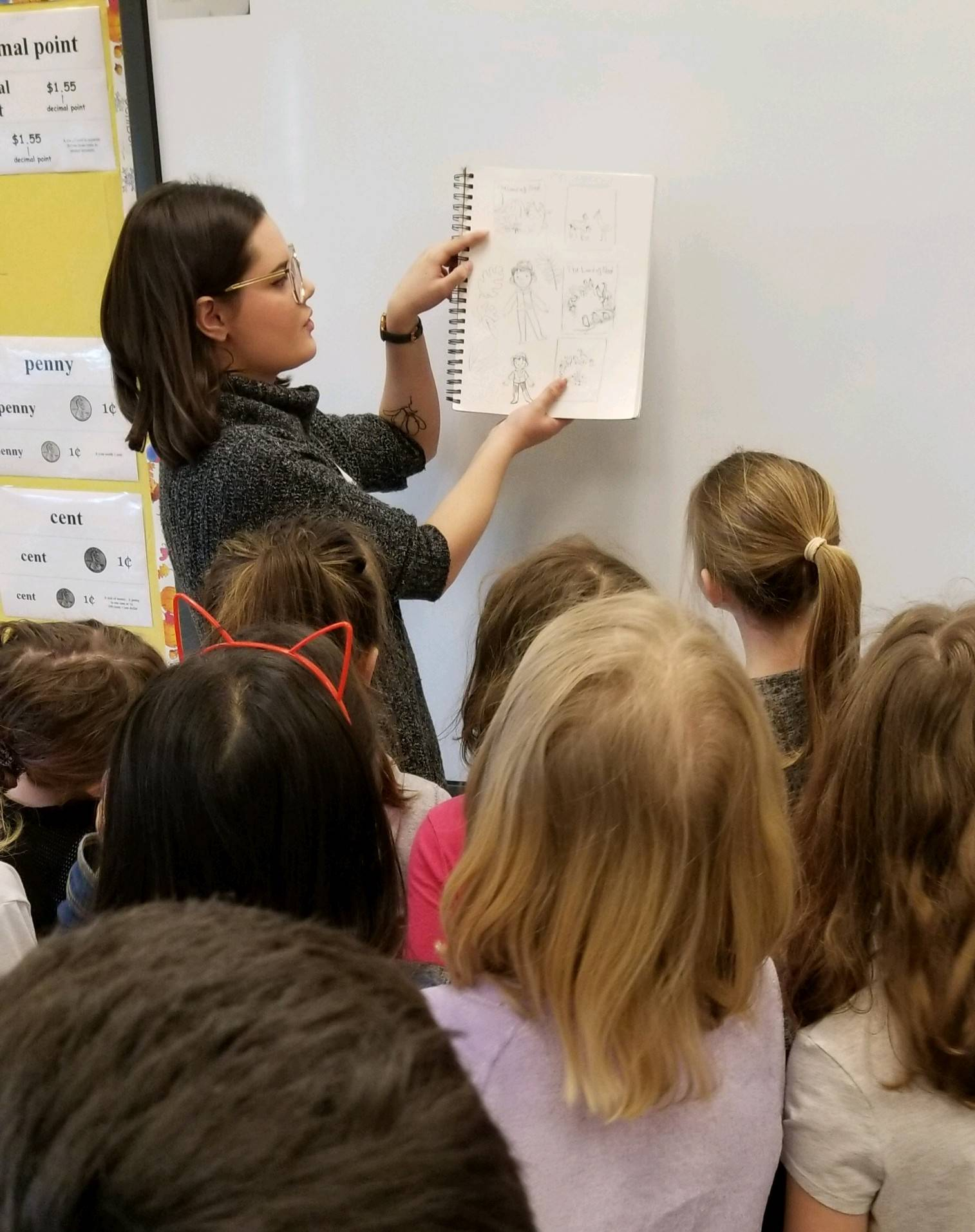 Illustrator showing students her work.