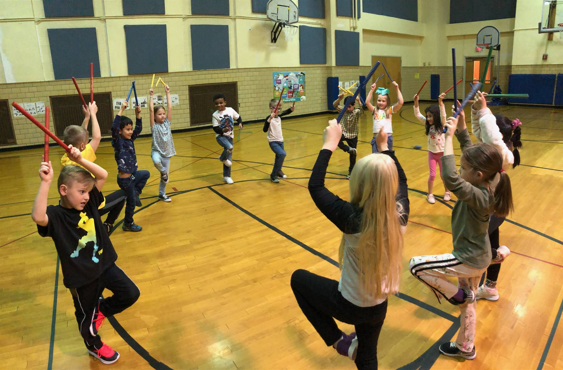 Students learning about music in gym class.